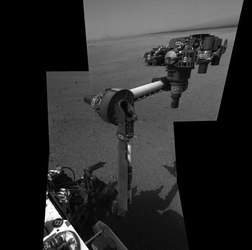 An image of Curiosity's first robotic arm extension. The image is a result of a mosaic of high-resolution images taken by the Navcam cameras. The arm is two metres long and ends in a turret with a spade to collect dust and a spectrometer to analyse the chemical composition of Martian rocks and soil. Credit: NASA/JPL-Caltech