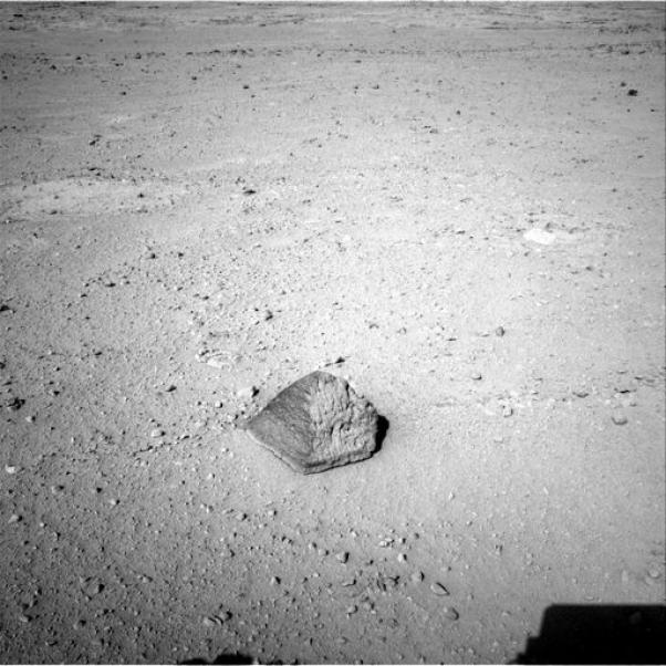 Image of the first rock studied by NASA's Curiosity rover. Its pyramid shape and its chemical composition  resemble some volcanic rocks on Earth. Credit: NASA/JPL-Caltech