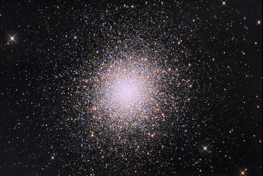 The Hercules Globular Cluster (also known as M13 from its position in the Messier Catalogue, or as NGC6205) is a globular cluster that is visible in the constellation Hercules, at a distance of about 25,000 light years from the Earth. It consists of various hundreds of thousands of stars. The estimated age is between 12 and 14 billion years. Even though it is remarkably far from the Earth, it is however the most luminous globular cluster in the northern hemisphere, and this implies that its brightness must be very great, superior to that of 300000 suns. Credits: Marco Burali, Tiziano Capecchi, Marco Mancini (Osservatorio MTM)