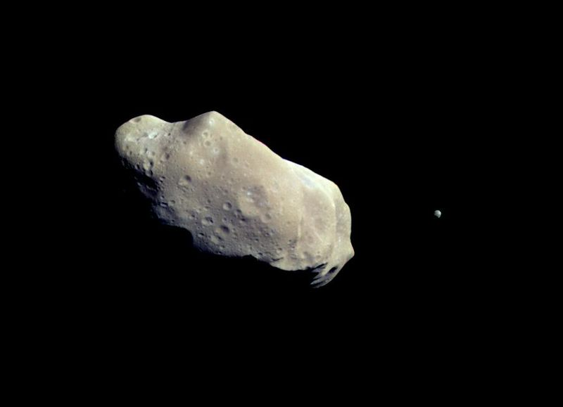 This image was taken by the Galileo probe about 14 minutes before the spacecraft made its closest approach to asteroid 243 Ida on 28 August 1993. A moon is visible to the right of the asteroid. It is Dactyl, the first satellite of an asteroid ever discovered. Credit: NASA