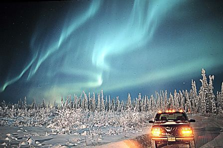 Photograph of an aurora borealis, or northern lights, in Alaska, about 75 km south of the Arctic Circle. Credits: Dick Hutchinson