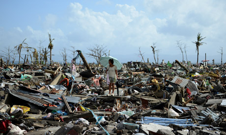 A survivor stands on the rubble left behind by the typhoon Haiyan at Tacloban, one of the cities that was hit most violently. Credits: Noel Celis/AFP Getty Images