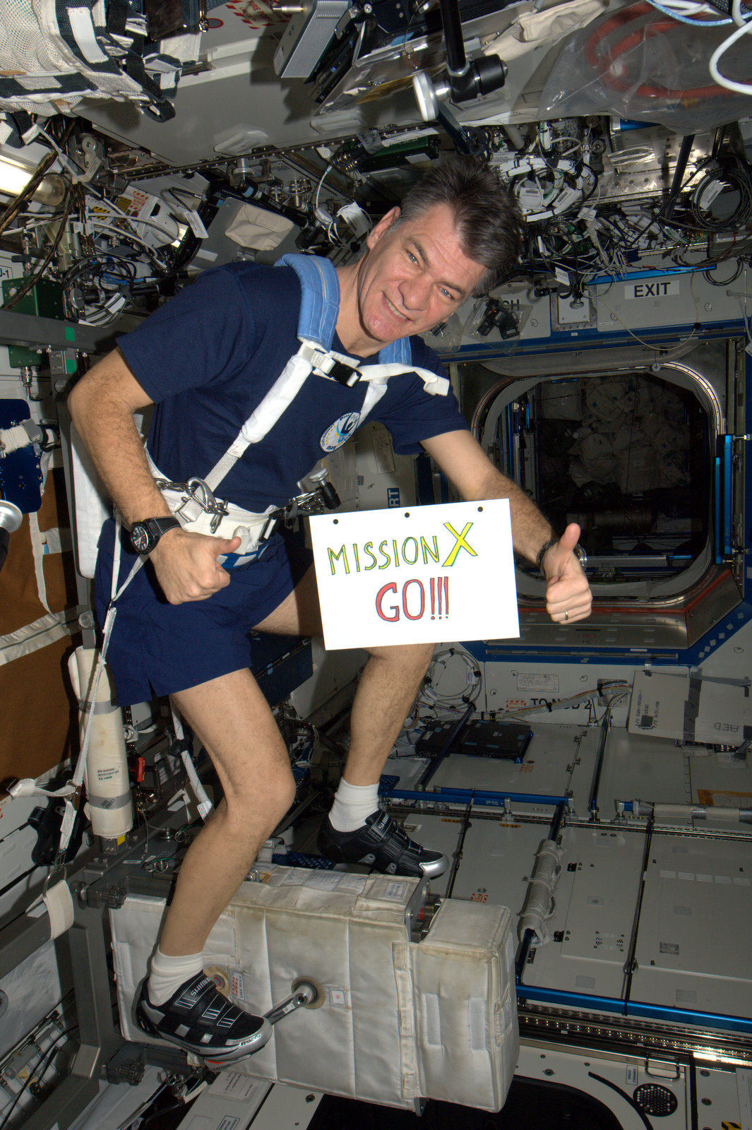 Paolo Nespoli during a session on the cyclette exercising bicycle, which is necessary in order to maintain the astronauts' muscle tone and to keep the blood circulation active. Credits: ESA/NASA