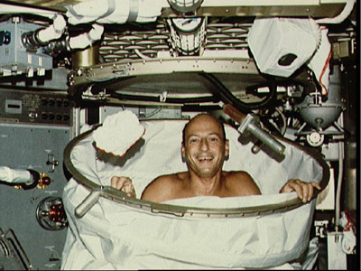 American astronaut Charles Conrad Jr., Commander of Skylab 2, smiles after a hot shower. Credits: NASA
