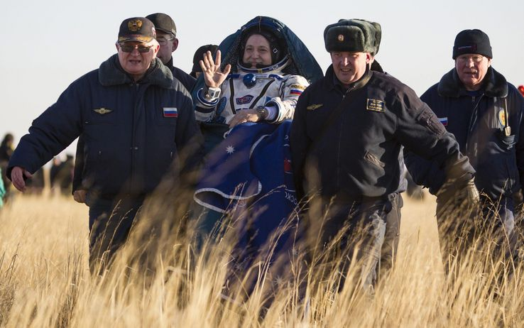 The Russian astronaut  Fyodor Yurchikhin carried on a seat, by the ground staff. Credits: NASA